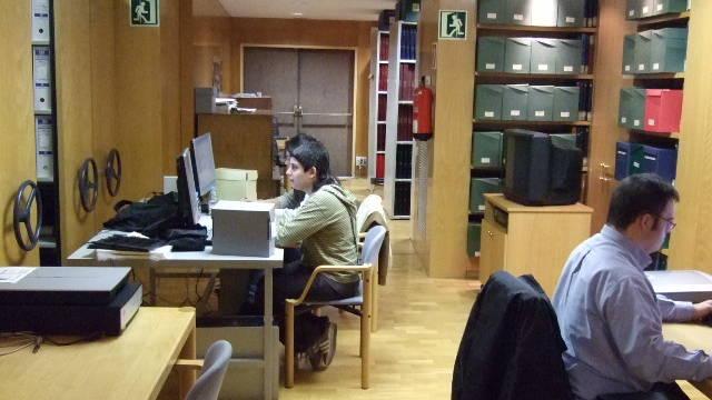 Image of people working at desks inside the documentation centre