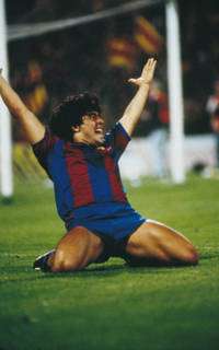 Photo of Diego Armando Maradona on his knees as he celebrates a goal