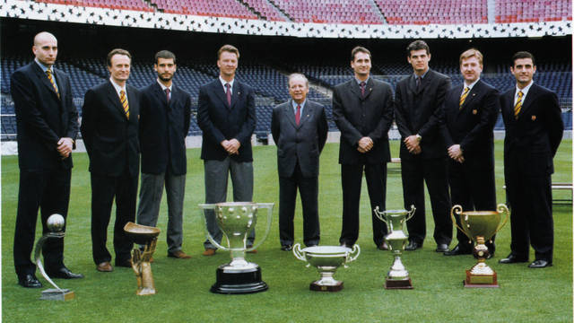 Picture of Van Gaal and his staff with the trophies they won from 97-99