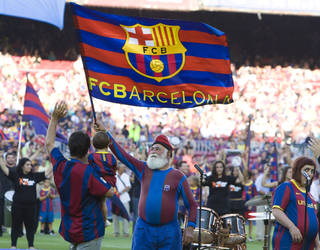 the barça grandfather carrying a barça banner during a concert in the stadium