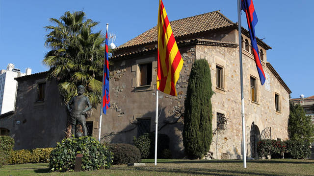 View of the old masia building with a catalan flag outside