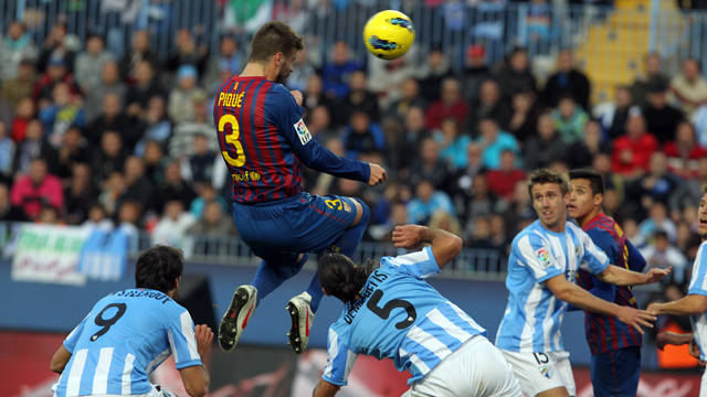 Piqué playing against Màlaga / PHOTO: MIGUEL RUIZ-FCB