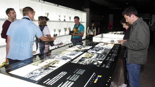 View of the trophy zone at the musem with people looking at the FCB history