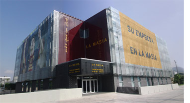 The facade of the new Masia with advertising
