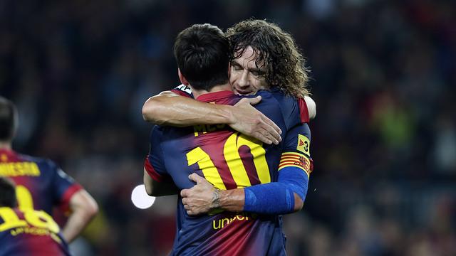 Puyol abraça Messi després d