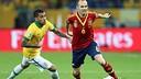 Alves and Iniesta / PHOTO: FIFA.COM