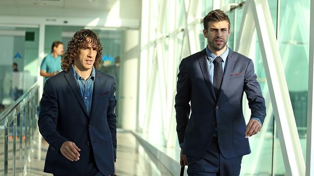 Puyol y Piqué, en el Aeropuerto. FOTO: MIGUEL RUIZ - FCB