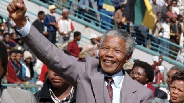 Image of a smiling Nelson Mandela
