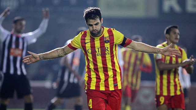 Cesc Fàbregas running and opening his arms to celebrate a goal