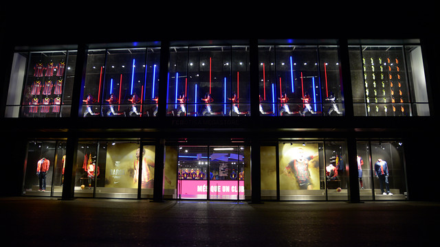 View from outside the shop illuminated at night