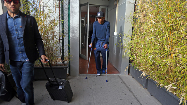 Neymar at the airport on crutches