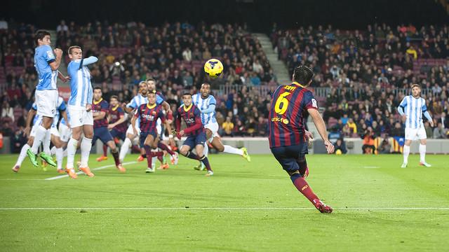 Xavi takes a free kick