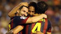 Messi, neymar and Fabregas celebrating a goal
