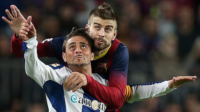 Piqué and Sergio García in the derby game at  Camp Nou / PHOTO: MIGUEL RUIZ-FCB
