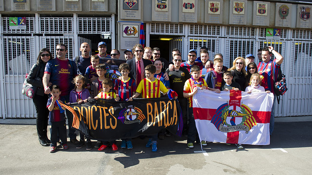 group of people holding banners in front of Camp Nou
