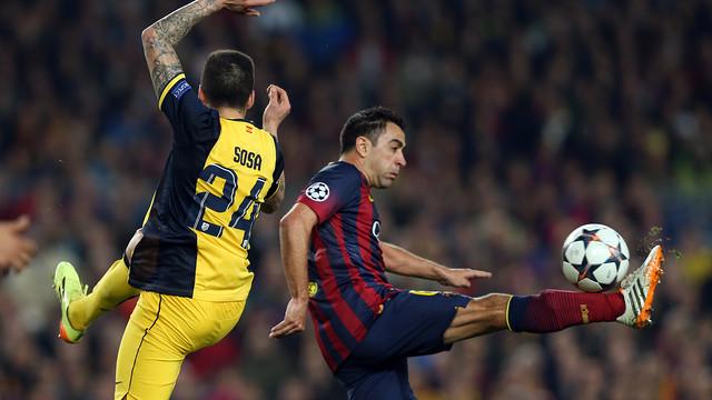 Xavi controls the ball with his leg in the air