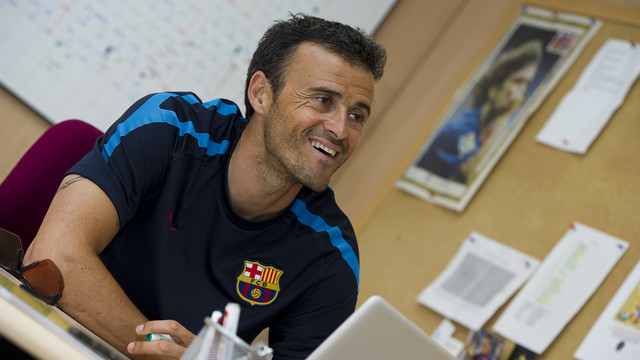 Luis Enrique seated and smiling