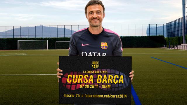 Luis Enrique, amb el cartell de la Cursa Barça 2014