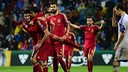 Bartra and Piqué congratulated Diego Costa after scoring the fourth goal of the evening / FIFA.COM
