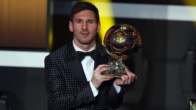 Leo Messi lifting up his fourth Ballon d'Or trophy/ PHOTO: FCB Archive