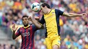 Alves and Godín in action in the same fixture last season / PHOTO: MIGUEL RUIZ- FCB