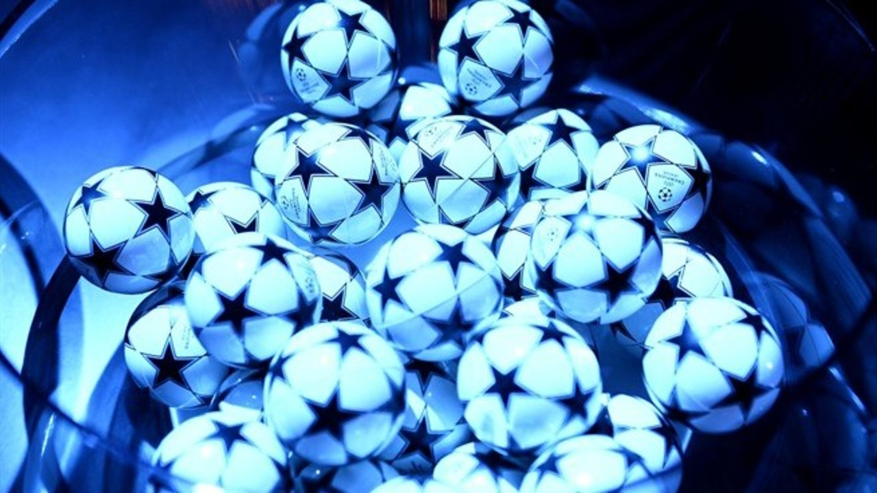 A bowl of ping pong-like balls is used for the Champions League draw. / UEFA.COM